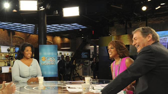 """In this image released by CBS, Oprah Winfrey, left, appears on """"CBS This Morning,"""" with co-hosts Gayle King and Charlie Rose, right, Monday, April 2, 2012 in New York. Winfrey says she still has faith in her troubled cable network. Appearing on the morning show, Winfrey told King that she believes the Oprah Winfrey Network will fulfill its mission of transforming viewers' lives. But if viewers don't respond, Winfrey says: """"I will move on to the next thing."""" OWN has struggled to build an audience since its launch in January 2011. (AP Photo/CBS, Heather Wines)"""