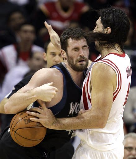 Love, Pekovic lead T'Wolves over Rockets 111-98