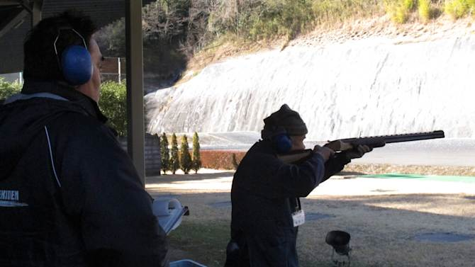 In this Friday, Jan. 18, 2013 photo, a Japanese shotgun enthusiast takes a test to renew his license on a shooting range in Ooi, at the foot of Mount Fuji. In this country, guns are few and far between. And so is gun violence. Guns were used in only seven murders in Japan - a nation of about 130 million - in all of 2011, the most recent year for official statistics. According to police, more people - nine - were murdered with scissors. (AP Photo/Eric Talmadge)