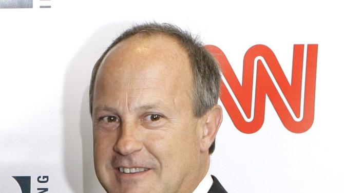 FILE - This April 18, 2007 file photo shows Jim Walton, president of CNN Worldwide, at a party held by CNN celebrating King's fifty years of broadcasting in New York. Walton is quitting, saying the beleaguered news network needs a different leader with a new perspective and plans. Walton built CNN into a profitable international news organization in his 10 years as boss. But the U.S. flagship network has suffered through some historically poor ratings in the past few months and is entrenched in third place behind rivals Fox News Channel and MSNBC in prime time. He announced his decision in an email to staff on Friday, July 27, 2012. (AP Photo/Stuart Ramson, file)