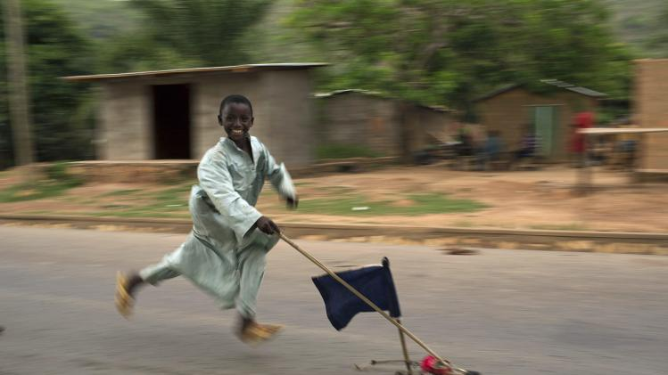 A boy runs past with a home made toy car in an area where several Muslims are still stranded due to the ongoing sectarian violence near Kilometre 12 (PK12) in the capital Bangui