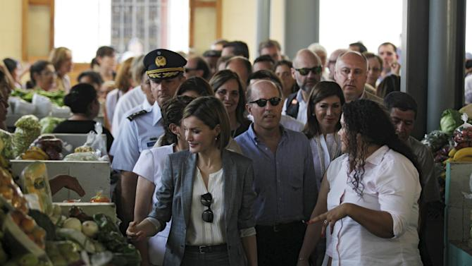 Spain's Queen Letizia and mayor Pedrina Rivera visit the central market of the town of Suchitoto, during an official visit to El Salvador