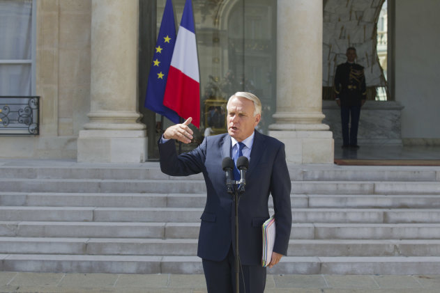 France's Prime Minister Jean-Marc Ayrault gestures as he speaks to the media as he leaves the first Cabinet meeting after the traditional August holiday, at the Elysee Palace in Paris, Wednesday, Aug. 22, 2012. Ayrault says his government will lower taxes on gasoline to ease the pinch of rising prices on French pocketbooks. (AP Photo/Michel Euler)