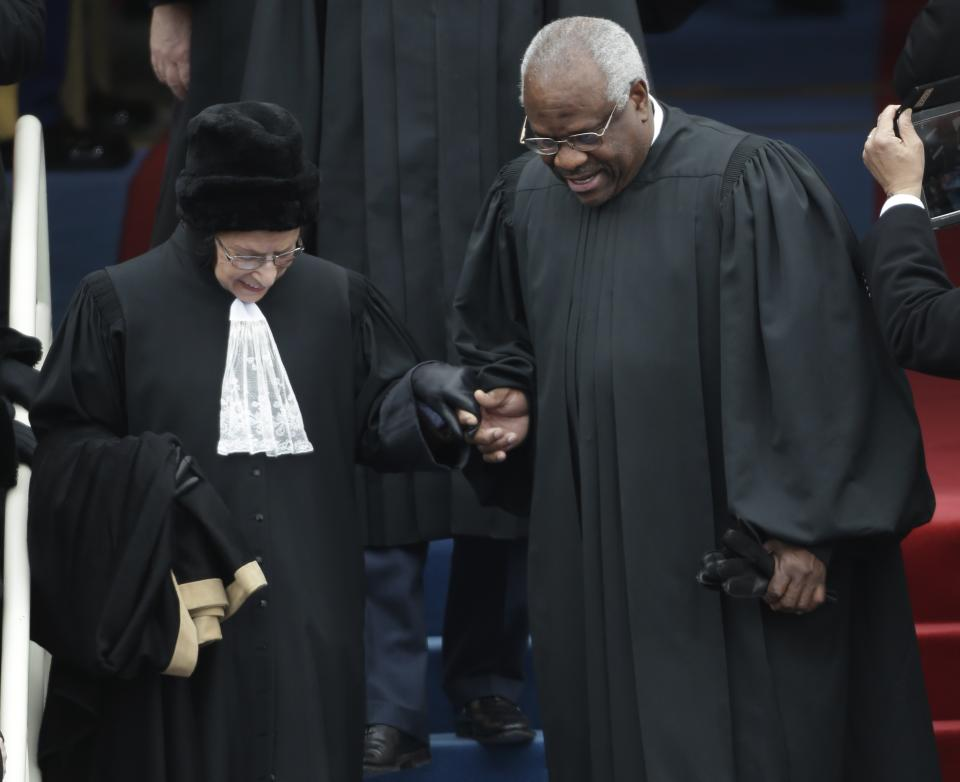 Supreme Court associate justices Ruth Bader Ginsburg, left and Clarence Thomas arrive at the ceremonial swearing-in for President Barack Obama at the U.S. Capitol during the 57th Presidential Inauguration in Washington, Monday, Jan. 21, 2013. (AP Photo/Pablo Martinez Monsivais)