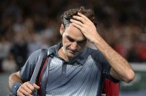 Federer of Switzerland leaves court after being defeated by Djokovic of Serbia at the Paris Masters tennis tournament in Paris