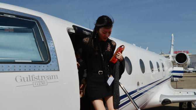 A Chinese woman leaving a Gulfstream G150 luxury jet at Shanghai Hongqiao airport on April 14, 2014