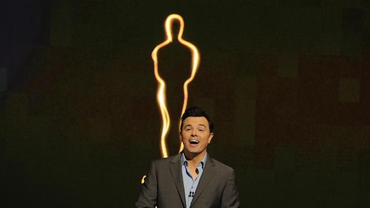 FILE - In this Jan. 13, 2013 file photo, 2013 Oscar host Seth MacFarlane presents the Academy nominations for the 85th Academy Awards in Beverly Hills, Calif.  MacFarlane may bring a cheekiness to Sunday's show that prods younger viewers to check out the Oscars just to see what he might pull. The 85th Academy Awards will be held in Los Angeles on Feb. 24, 2013. (Photo by Chris Pizzello/Invision/AP Photo, File)