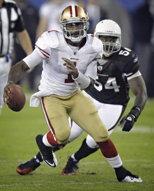 San Francisco 49ers quarterback Troy Smith (1) scrambles as Arizona Cardinals linebacker Gerald Hayes pursues during the first quarter of an NFL football game Monday, Nov. 29, 2010, in Glendale, Ariz. (AP Photo/Paul Connors)