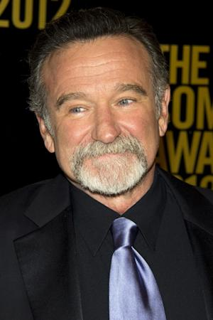 """FILE - In this April 28, 2012 file photo, Robin Williams appears onstage at The 2012 Comedy Awards in New York. Fox 2000 is developing a sequel to the 1993 hit """"Mrs. Doubtfire"""" with """"Elf"""" writer David Berenbaum attached to pen the script for the comedy, confirmed the studio on Thursday, April 17, 2014. While there are no deals in place, insiders say that Chris Columbus is back on board to direct and Williams will reprise his starring role. (AP Photo/Charles Sykes, file)"""