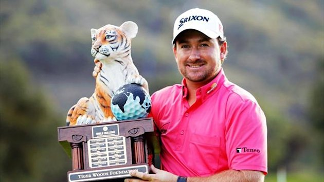 Graeme McDowell with his World Challenge trophy (Reuters)
