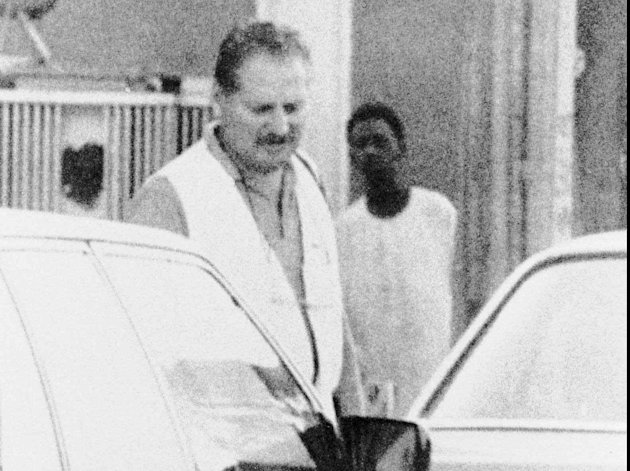 FILE- August 1994 file of Carlos &quot;The Jackal&quot; walking in the streets of Khartoum, Sudan. Carlos, whose real name is Ilich Ramirez Sanchez, the flamboyant terrorist and self-proclaimed revolutionary who was once one of the Cold War's most wanted men, is appealing Monday May 13, 2013 his two life sentences for orchestrating bombings in France two decades ago. He's been jailed since 1994 after French agents seized him in Sudan. (AP Photo/File)