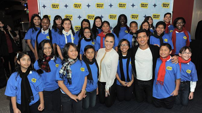 IMAGE DISTRIBUTED FOR BEST BUY - Best Buy welcomes Mario Lopez, Khloé Kardashian Odom and the Bancroft Middle School choir to celebrate the holidays on Wednesday, Dec. 12, 2012 at the Westfield Mall Best Buy in Culver City, Calif. (Photo by Jordan Strauss/Invision for Best Buy/AP Images)
