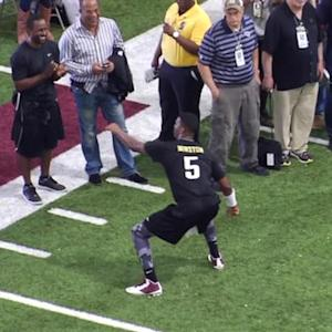 Florida State University quarterback Jameis Winston celebrates end of pro day