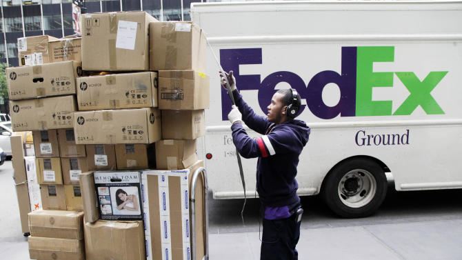 FedEx predicts slower earnings growth this year