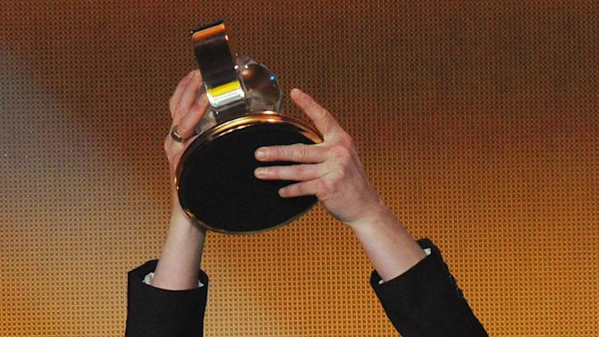 Pia Sundhage, former coach of the Women's soccer team of the United States, is awarded FIFA Women's World Coach of the Year during the FIFA Ballon d'Or Gala 2013 held at the Kongresshaus in Zurich, Switzerland, Monday, Jan. 7, 2013. (AP Photo/Keystone, Steffen Schmidt)