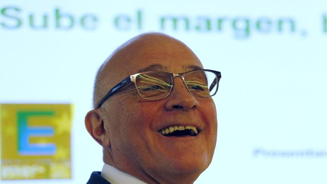 Banc Sabadell's Chairman Josep Oliu smiles after a news conference presenting 2014 results at its headquarters in central Barcelona