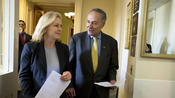 """FILE - In this Jan. 4, 2013, file photo, Sen. Charles Schumer, D-N.Y., right, accompanied by Sen. Kirsten Gillibrand, D-N.Y, enter a news conference on Capitol Hill in Washington, to discuss Superstorm Sandy aid. Conservatives and watchdog groups are mounting a """"not-so-fast"""" campaign against a $50.7 billion Superstorm Sandy aid package that Northeastern governors and lawmakers hope to push through the House the week of Jan. 14, 2013. Their complaint is that lots of that money actually will go toward recovery efforts for past disasters and other projects unrelated to the late-October storm. The measure bill includes $150 million for what the Commerce Department described as fisheries disasters in Alaska, Mississippi and the Northeast, and $50 million in subsidies for replanting trees on private land damaged by wildfires. (AP Photo/Jacquelyn Martin)"""