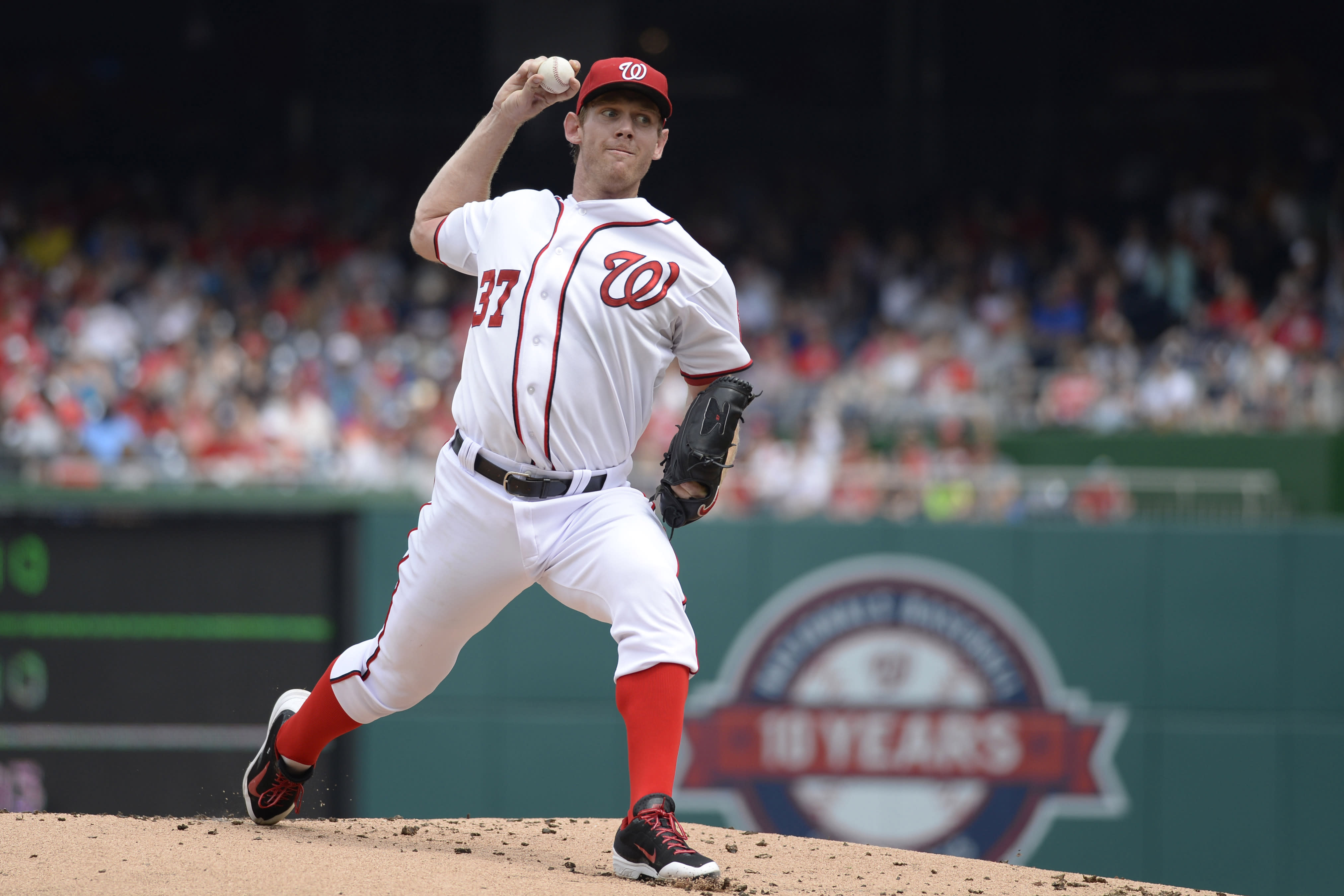 Strasburg leaves Nats win over Marlins with injury