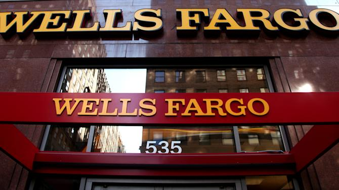 FILE-In this May 6, 2012, file photo, a Wells Fargo sign is displayed at a branch in New York.  The federal government sued Wells Fargo Bank in New York on Tuesday, Oct. 9, 2012, blaming the nation's largest originator of home mortgages for thousands of loan defaults over the last decade(AP Photo/CX Matiash, File)