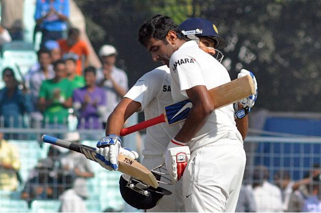 Indian batsman Rohit Sharma congratulates fellow batsman Ravichandran Ashwin after he scored a century during the 3rd day of the 1st test match between India and West Indies at Eden Gardens, Kolkata o
