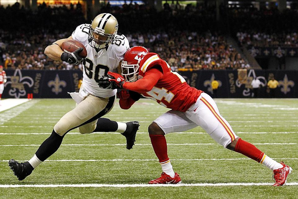New Orleans Saints tight end Jimmy Graham (80) crosses the goal line for a touchdown as Kansas City Chiefs cornerback Brandon Flowers (24) covers in the second half of an NFL football game in New Orleans, Sunday, Sept. 23, 2012. (AP Photo/Bill Haber)