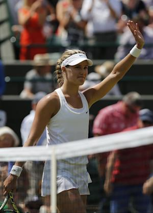 Eugenie Bouchard of Canada celebrates defeating Angelique Kerber of Germany in their women's singles quarterfinal match at the All England Lawn Tennis Championships in Wimbledon, London, Wednesday, July 2, 2014. (AP Photo/Ben Curtis)