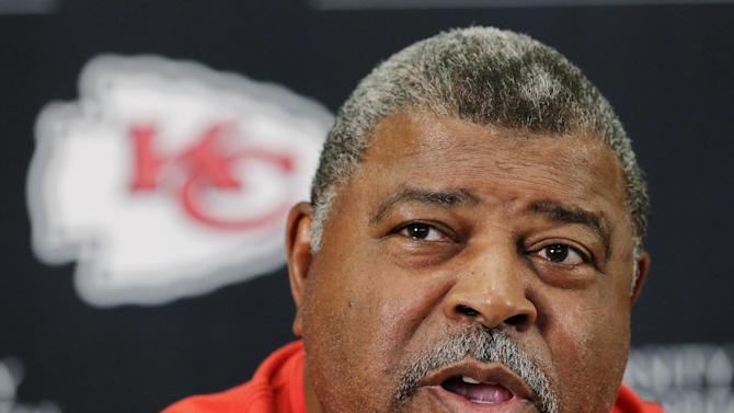 Kansas City Chiefs head coach Romeno Crennel talks about the murder-suicide committed by linebacker Jovan Belcher during an NFL football news conference, Monday, Dec. 3, 2012, at the team's practice facility in Kansas City, Mo. Belcher shot and killed his 22-year-old girlfriend, Kasandra Perkins, at their Kansas City home Saturday before driving to Arrowhead Stadium, where Belcher committed suicide in the practice facility's parking lot after meeting with Crennel and general manager Scott Pioli, police said. (AP Photo/Charlie Riedel)