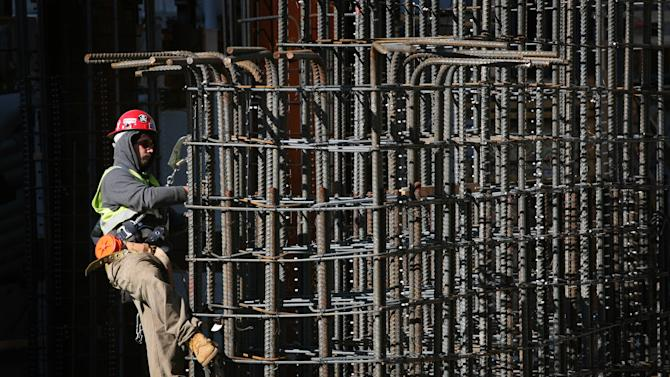 FILE - In this Oct. 22, 2008 file photo, a construction worker ties together steel reinforcing bars at the World Trade Center site in New York. (AP Photo/Mark Lennihan)