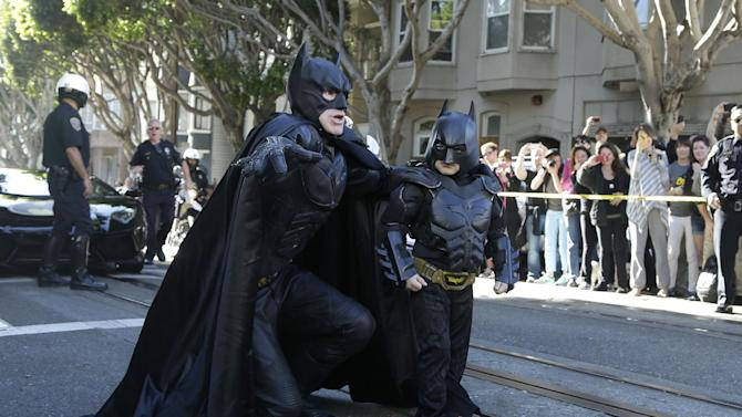 "AP10ThingsToSee - Miles Scott, dressed as Batkid, right, walks with Batman before saving a damsel in distress in San Francisco, Friday, Nov. 15, 2013. San Francisco turned into Gotham City on Friday, as city officials helped fulfill Scott's wish to be ""Batkid."" Scott, a leukemia patient from Tulelake in far Northern California, was called into service on Friday morning by San Francisco Police Chief Greg Suhr to help fight crime, The Greater Bay Area Make-A-Wish Foundation says. (AP Photo/Jeff Chiu)"