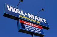 <p>               FILE - In this May 16, 2011 file photo, the WalMart Supercenter signage is seen in Springfield, Ill.  Wal-Mart Stores Inc. is reporting Tuesday, Feb. 21, 2012, a 4.2 percent decline in fourth-quarter profits. But the world's largest retailer's U.S. namesake business continued its rebound as its grabbed shoppers over the critical holidays. (AP Photo/Seth Perlman, File)