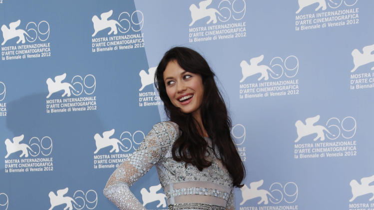 Actress Olga Kurylenko poses at the photo call of the film 'To The Wonder' at the 69th edition of the Venice Film Festival in Venice, Italy, Sunday, Sept. 2, 2012. (AP Photo/Joel Ryan)