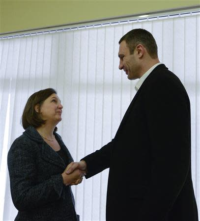 U.S. Assistant Secretary of State Nuland shakes hands with UDAR leader Klitschko during their meeting in Kiev