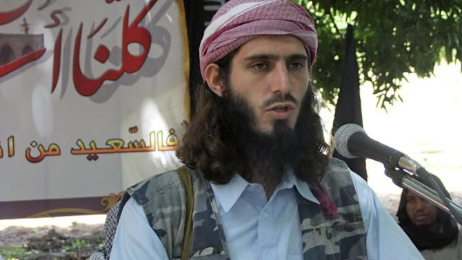 FILE - In this Wednesday, May 11, 2011 file photo, American-born Islamist militant Omar Hammami, 27, also known as Abu Mansur al-Amriki, addresses a press conference of the militant group al-Shabab at a farm in southern Mogadishu's Afgoye district in Somalia. A 50-member group of U.S. government workers comprised of Americans and foreign nationals called the Digital Outreach Team is countering extremist propaganda on sites like Twitter and Facebook, with the top official on the team, Alberto Fernandez, saying the goal is to contest space that had previously been ceded to extremists. (AP Photo/Farah Abdi Warsameh, File)