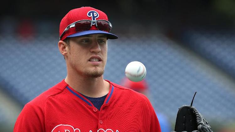 Philadelphia Phillies' Ken Giles warms up in batting practice before the start of a baseball game with the St Louis Cardinals, Friday, Aug. 22, 2014, in Philadelphia. (AP Photo/Laurence Kesterson)