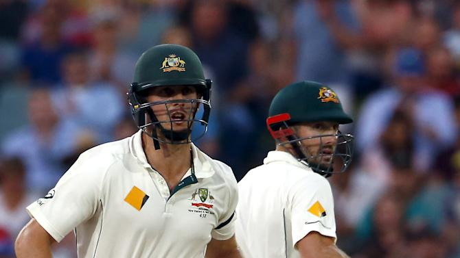 Australia's Shaun Marsh runs between wickets with his brother and team mate Mitchell Marsh during the third day of the third cricket test match against New Zealand at the Adelaide Oval, in South Australia
