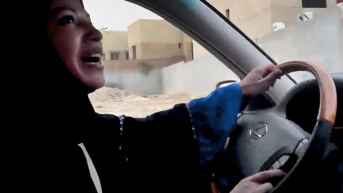 FILE - In this Friday, June 17, 2011 file image made from video released by Change.org, a Saudi Arabian woman drives a car as part of a campaign to defy Saudi Arabia's ban on women driving, in Riyadh, Saudi Arabia. It's been a little more than two years since the last time women in Saudi Arabia campaigned for the right to drive. Since then, the monarchy has made incremental but key reforms, and activists hope that has readied the nation for greater change as they call for women to get behind the wheel in a new campaign Saturday, Oct. 26, 2013. Ultraconservatives are pushing back with protests, threats and even a cleric's warning that driving a car damages a woman's ovaries.(AP Photo/Change.org, File)