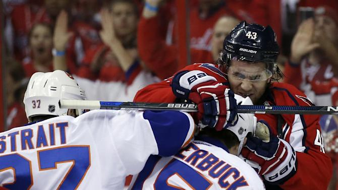 New York Islanders defenseman Brian Strait (37) and right wing Cal Clutterbuck (15) scuffle with Washington Capitals right wing Tom Wilson (43) during the first period of Game 7 in the first round of the NHL hockey Stanley Cup playoffs, Monday, April 27, 2015, in Washington. (AP Photo/Alex Brandon)