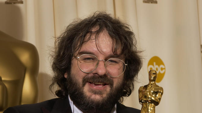 "FILE - In this Feb. 29, 2004 file photo, director Peter Jackson holds the Oscar he won for best director for his work on ""The Lord of the Rings: The Return of the King,"" at the 76th annual Academy Awards, in Los Angeles. (AP Photo/Reed Saxon, File)"