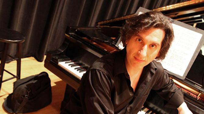 """This July 8, 2014, photo shows Hershey Felder at the piano onstage at The Town Hall, where he will perform his one-man show about Leonard Bernstein called """"Maestro Bernstein."""" Felder has made a career of portraying composers as George Gershwin, Frederic Chopin and Ludwig van Beethoven. (AP Photo/Mark Kennedy)"""