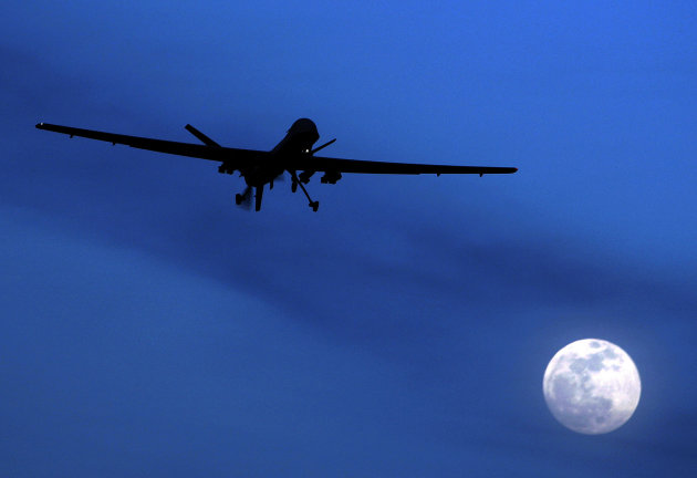 FILE - In this Jan. 31, 2010, file photo an unmanned U.S. Predator drone flies over Kandahar Air Field, southern Afghanistan, on a moon-lit night. The Obama administration's increasing use of unmanned drone strikes to kill terror suspects is widely opposed around the world, according to a Pew Research Center survey on the U.S. image abroad. (AP Photo/Kirsty Wigglesworth, File)