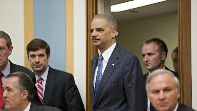 Attorney General Eric Holder, the nation's top law enforcement official, arrives on Capitol Hill in Washington, Wednesday, May 15, 2013, to testify before the House Judiciary Committee oversight hearing on the Justice Department. House Judiciary Committee Chairman Rep. Bob Goodlatte,R-Va., wants to know more about the unwarranted targeting of Tea Party and other conservative groups by the Internal Revenue Service and the Justice Department's secret seizure of telephone records at The Associated Press.  (AP Photo/J. Scott Applewhite)