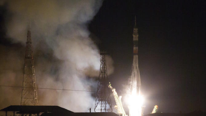 The Soyuz-FG rocket booster with Soyuz TMA-15M space ship carrying a new crew to the International Space Station, ISS, blasts off at the Russian leased Baikonur cosmodrome, Kazakhstan, Monday, Nov. 24, 2014. The Russian rocket carries U.S. astronaut Terry Virts, Russian cosmonaut Anton Shkaplerov, and Italian astronaut Samantha Cristoforetti. (AP Photo/Dmitry Lovetsky)