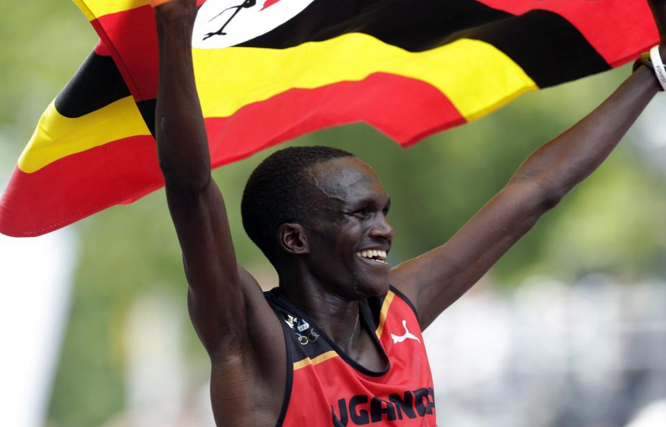 Stephen Kiprotich of Uganda celebrates winning the men's marathon at the 2012 Summer Olympics in London, Sunday, Aug. 12, 2012. (AP Photo/Luca Bruno)