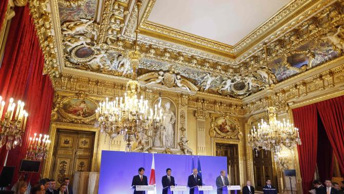 Japan's Defence Minister Onodera, Japan's Foreign Minister Kishida, French Foreign Minister Fabius and Defence Minister Le Drian attend a news conference at the Quai d'Orsay ministry in Paris