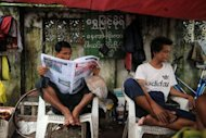 A Myanmar man reads a local journal in Yangon on August 20, 2012. Myanmar says it has abolished media censorship, delighting journalists who have lived for decades under the shadow of the censors' marker pen