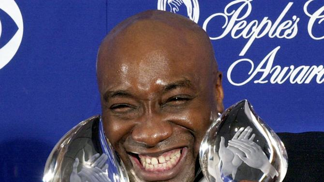 "FILE - In this Jan. 7, 2001 file photo, actor Michael Clarke Duncan shows off two awards for the film ""The Green Mile"" at the 27th Annual People's Choice Awards in Pasadena, Calif. Duncan's fiancee says the Oscar nominee for ""The Green Mile"" has died Monday, Sept. 3, 2012 while being hospitalized following a July heart attack. He was 54. (AP Photo/Michael Caulfield, File)"