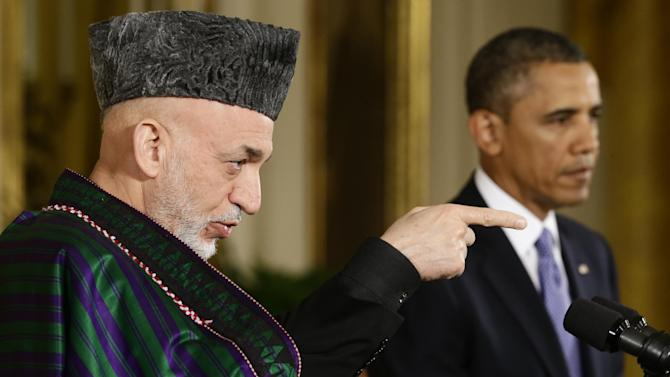 FILE - Afghan President Hamid Karzai takes questions from reporters