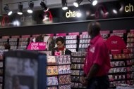 A woman looks at items for sale at a branch of HMV on Oxford Street in London, Tuesday, Jan. 15, 2013. British music and entertainment retailer HMV admitted defeat on Tuesday after more than 90 years on the U.K high street, suspending trading in its shares and calling in administrators to try to salvage any viable parts of the business. HMV is the last big retail chain selling recorded music in Britain and employs more than 4,000 people working in 238 stores, which will remain open for the time being. The company&#39;s management confirmed that it had failed to gain agreements with lenders and suppliers to continue trading. (AP Photo/Matt Dunham)