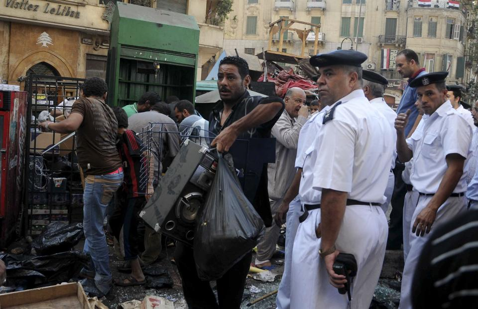 Egyptian street vendors salvage what they can of their belongings after police cleared Tahrir Square in Cairo, Egypt, Saturday, Sept. 15, 2012 after days of protests near the U.S. embassy over a film insulting Prophet Muhammad. (AP Photo/Mohammed Asad)