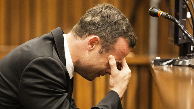 Oscar Pistorius, puts his hand to his face while listening to evidence from a witness speaking about the morning of the shooting in court on the fourth day of his trial at the high court in Pretoria, South Africa, Thursday, March 6, 2014. Pistorius is charged with murder for the shooting death of his girlfriend, Reeva Steenkamp, on Valentines Day in 2013. (AP Photo/Marco Longari, Pool)